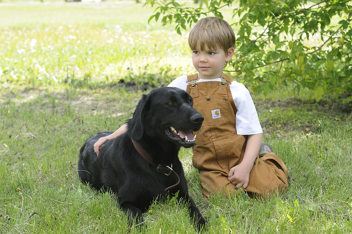 portrait of a young boy with his dog
