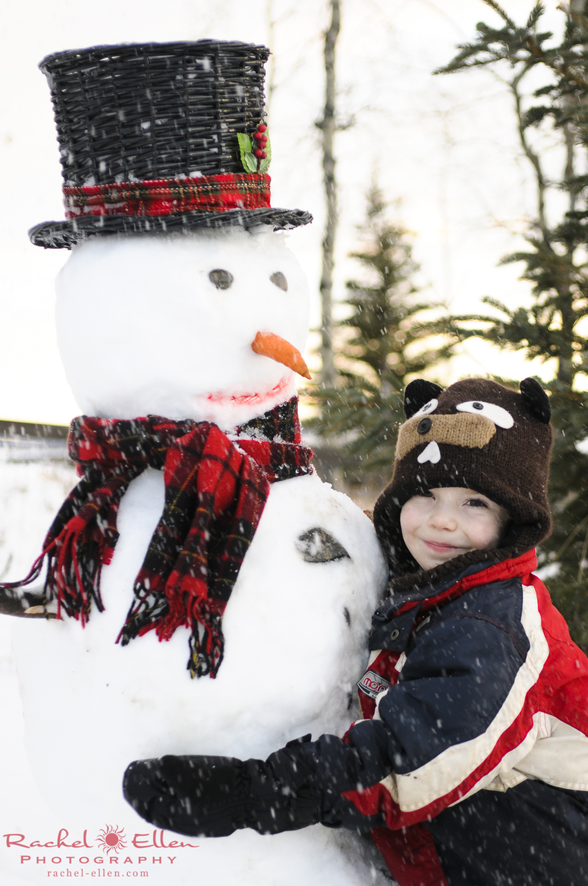child's portrait with snowman