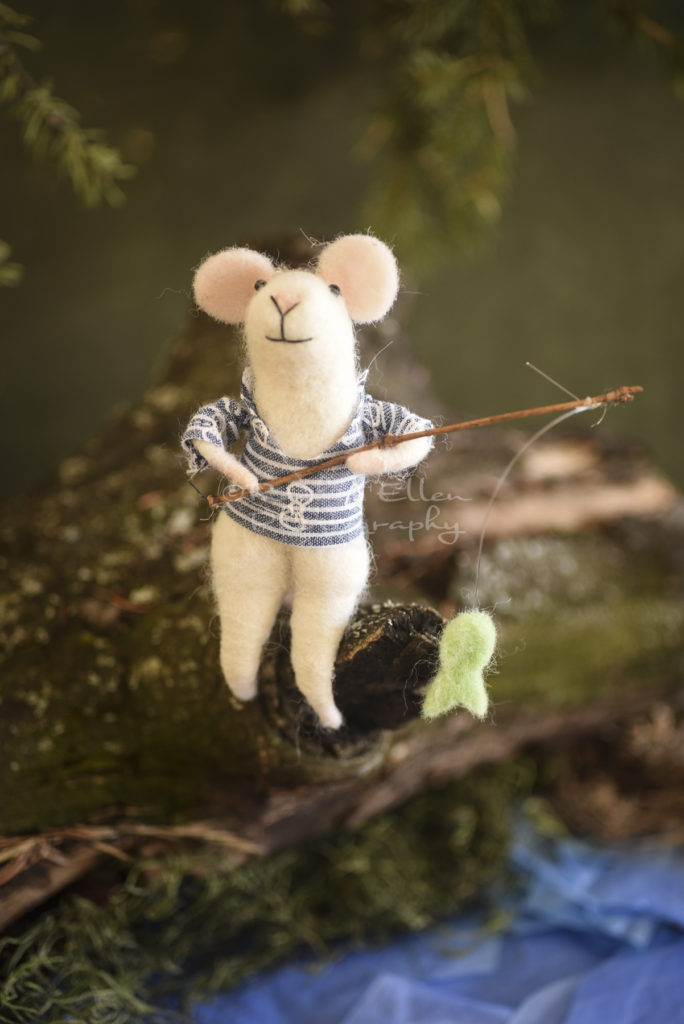 felted mouse fishing in pond